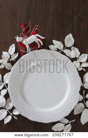 Christmas Table Setting, White Sheets Decorated Plate On Wooden Table