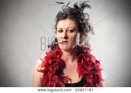 Elegant snobbish woman smoking a cigarette