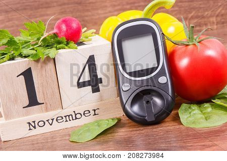 Date 14 November As Symbol Of World Diabetes Day, Glucose Meter For Measuring Sugar Level And Vegeta