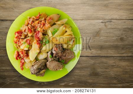 Fried Liver With Potatoes And Stewed Tomatoes.