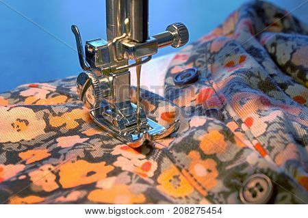 a sewing machine and item of clothing