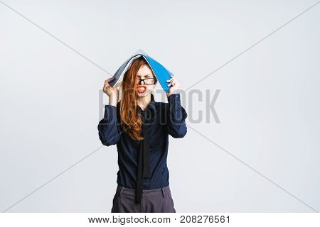 girl secretary with glasses irritatedly holding a folder over her head