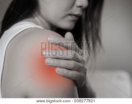 Closeup female's shoulder pain and injury. Health care and medical concept.