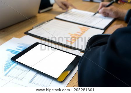Businessman And Staff Working  On Wood Table With White Tablet Screen Clipping Path.