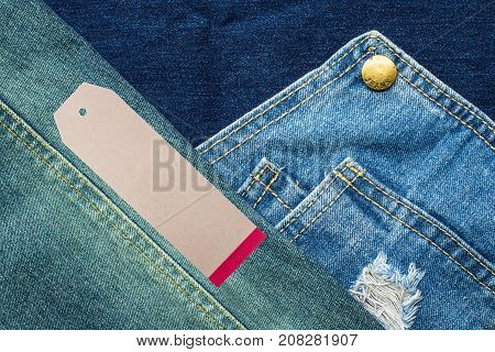 Rip denim jeans background with seam of jeans fashion design and tag