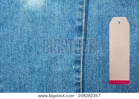 Denim jeans background with seam of jeans fashion design and tag