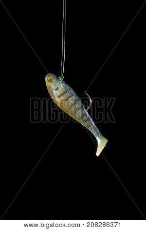 Fishing lures with a hook on a black background