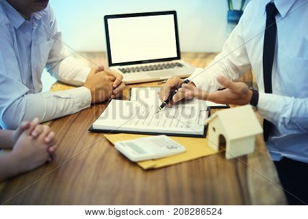Business Man Agreement To Sign For Contract For New Home Buy Or Rent