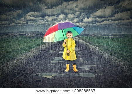 kid with umbrella and heavy rain