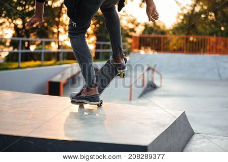 Close up of a young skateboarder in action on a ramp