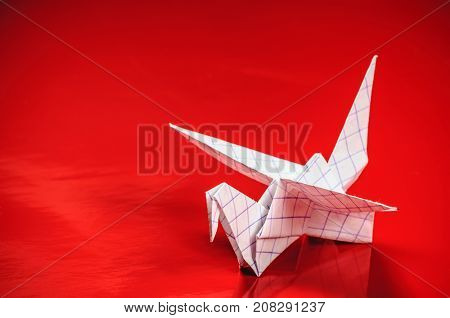 origami crane on red background