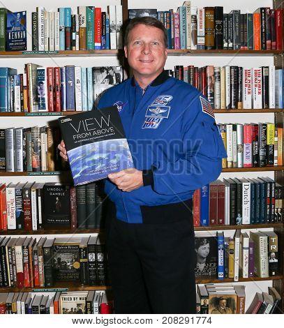 HUNTINGTON, NY - OCT 3: Commander Terry Virts signs