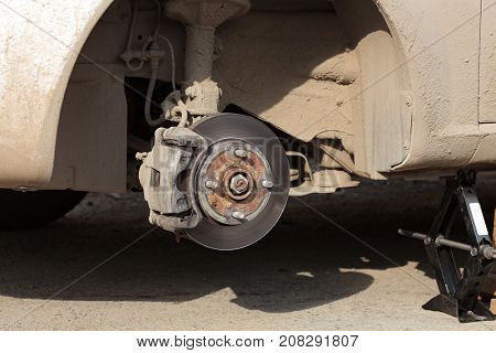 Closeup shot of car's disc brake without wheel on it
