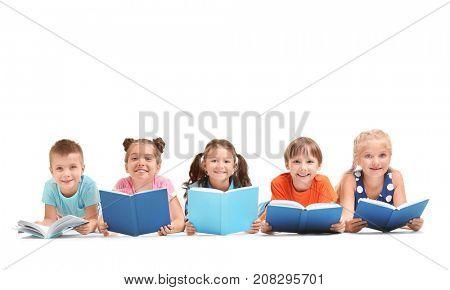 Cute little children reading books on white background
