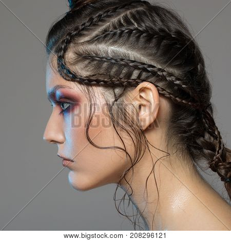 Fashion portrait of beautiful woman. Fantasy make-up and hairstyle.