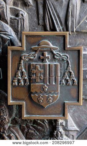 VARAZDIN, CROATIA - JULY 09: The coat of arms of Bishop Marko Culej, detail of the entrance door of cahedral of Assumption in Varazdin, Croatia on July 09, 2016.