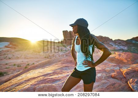 fit african american woman hiker looking out across desert at valley of fire park