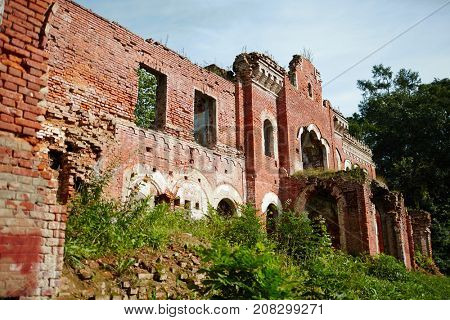 Half-ruined walls of neglected construction somewhere in the forest