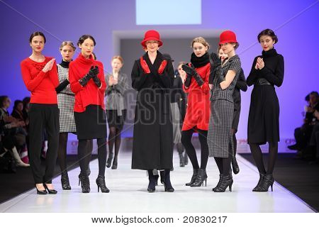 MOSCOW - FEBRUARY 22: Models in wear fashions by UNQ in the Collection Premiere Moscow,  an international fashion fair for Eastern Europe, on February 22, 2011 in Moscow, Russia.