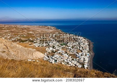 Aerial view town Perissa to Kamari in Santorini Greece