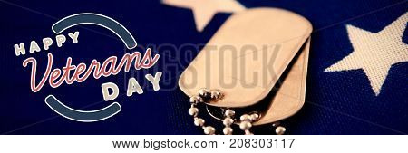 Logo for veterans day in america  against close-up of dog tag pendant on flag