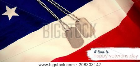 Logo for veterans day in america hashtag against high angle view of dog tag chains on flag