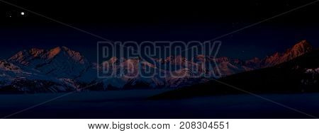 Night in Swiss Alps. Landscape of Crans-Montana range in Swiss Alps mountains with peak in background, Crans Montana, Switzerland.