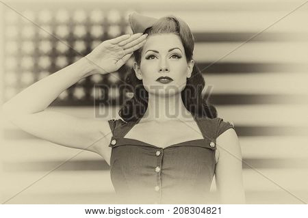 A pinup model in vintage clothing in front of an American Flag poster