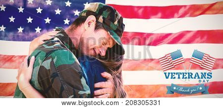 Logo for veterans day in america  against american soldier reunited with his partner