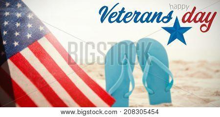 Logo for veterans day in america  against blue flip flop in sand