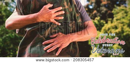 Midsection of army woman embracing father against logo for veterans day in america