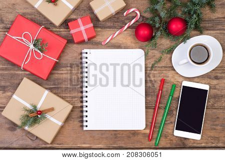 Blank notebook on wooden table with Christmas decoration