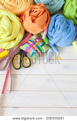 Colored Fabric Folded In The Form Of Rose Flowers. Scissors, Tape Measure, Needle, Needle Bar, Butto