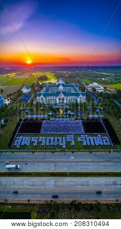 On Nov 25,2016. The people of Suphanburi, Thailand. Gather for a dedication ceremony of mourning the death of His Majesty the King Bhumibol Adulyadej. People card stunts. Mean