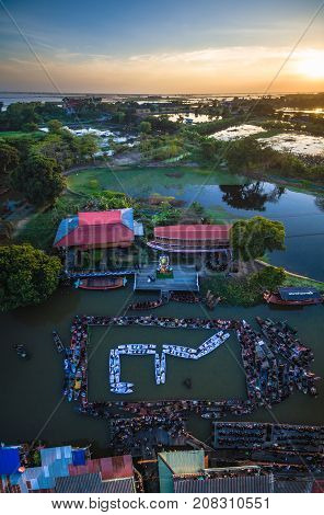 On Dec 4,2016. The people of Phak-Hai, Ayutthaya, Thailand. Gather for a dedication ceremony of mourning the death of His Majesty the King Bhumibol Adulyadej. People card stunts by boat on river. Mean