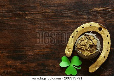 The symbol of St. Patrick's Day is a golden horseshoe and a clover