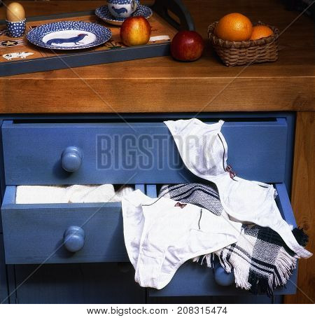 White And Luxury Female Underwear Laying On Drawer