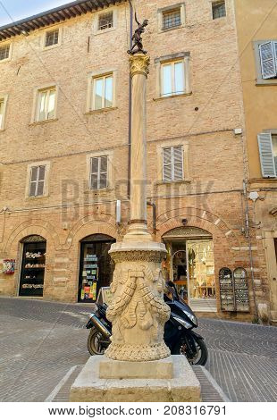 Urbino - Obelisk With Bronze Statue Of St. Crescentino