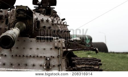the remains of a Soviet tank in a field
