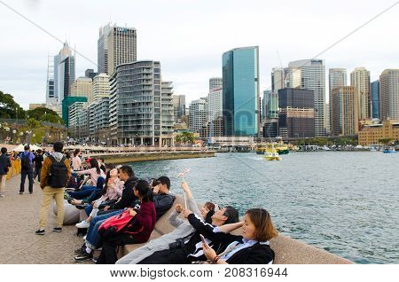 SYDNEY AUSTRALIA - AUGUST 11 2017: Visitors at Sydney Circular Quay a major tourist attraction in Sydney Business District New South Wales Australia.