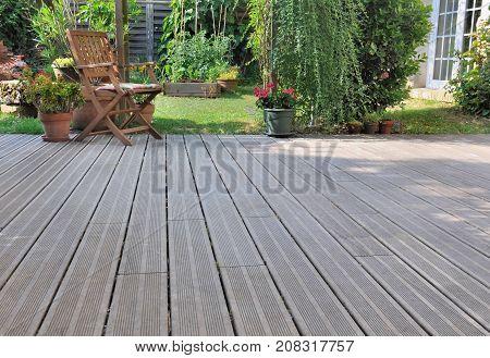 chair on wooden terrace in a garden