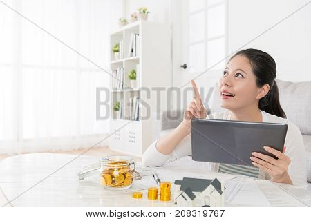 Happy Beautiful Housewife Using Mobile Pad