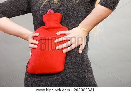 Girl Having Back Pain, Holding Hot Water Bottle