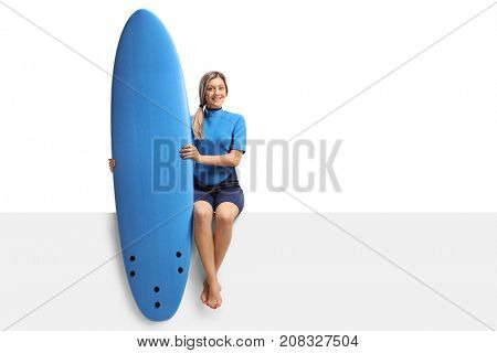 Female surfer with a surfboard sitting on a panel isolated on white background