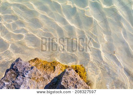 Beautiful crystal clear blue water texture background of the Mediterranean refracting light caustic patterns, Comino, Malta, holiday destination