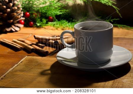 Image of coffe cup and christmas tree decoration. Top view