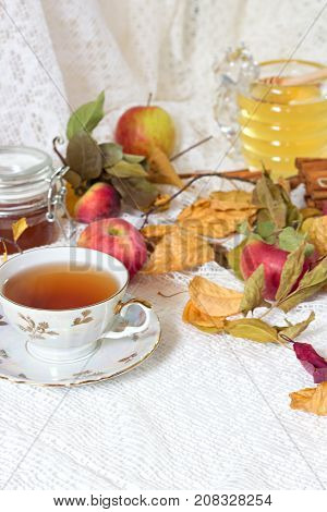 Vintage Tea Party - Tea Cups, Apples And Honey On White Wooden Table