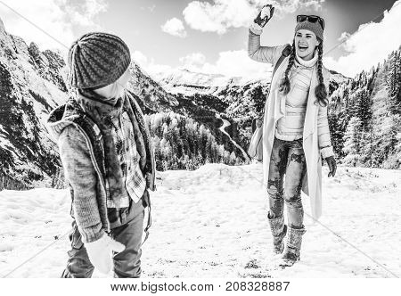 Mother And Child Travellers Playing Snowballs