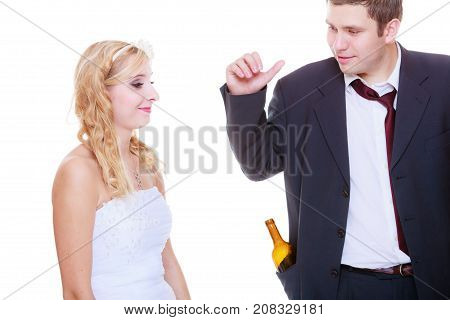 Addiction in relationship marriage problems and troubles concept. Bride having argument with drunk alcoholic groom.