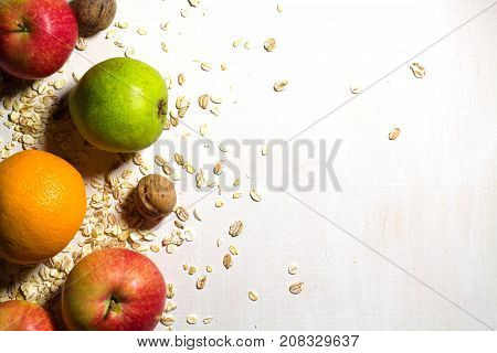Fruits. Various fresh ripe fruits close-up: pears apples and nuts scattered on neutral gradient background